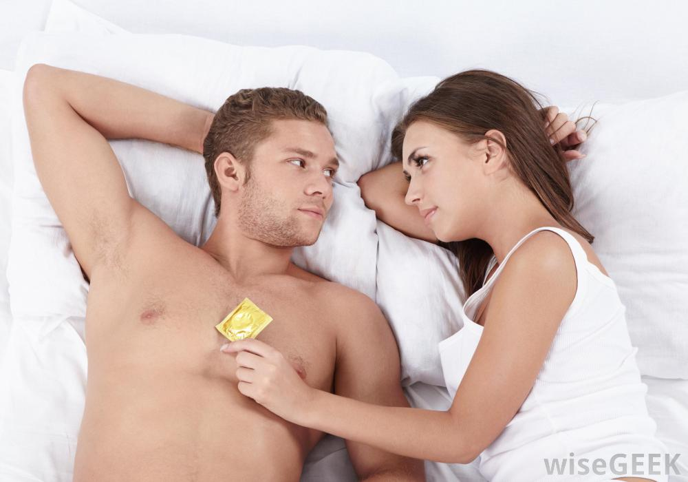 woman-and-man-in-bed-with-condom
